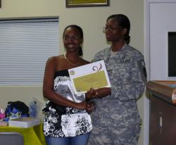 Volunteer Melinda Maynard receives a certificate of appreciation from VING Col. Linda Cills.