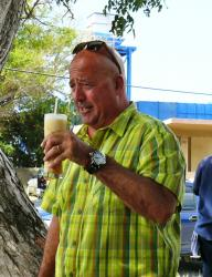 Bizarre Foods America host Andrew Zimmern with a healthful local drink combo of soursop, peanut punch, sea moss, oatmeal and pumpkin (Bill Kossler photo).
