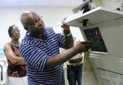 Patrick Phillips of P and P Communications demonstrates how voting machines are tested and operated.