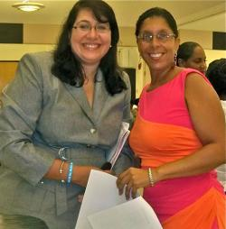 Dr. Lillian Santos, left, and Yvonne Galiber at Saturday's cancer awareness conference.