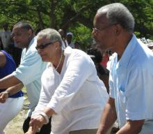 From left, USVI Gov. John deJongh Jr., acting BVI Gov. V. Inez Archibald and BVI Premier Dr. Orlando Smith dance up a storm.