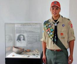 Boy Scout Troop 227's newest Eagle Scout, Ricardo 'Danny' Nieves, stands in front of the display case he put together for his project.