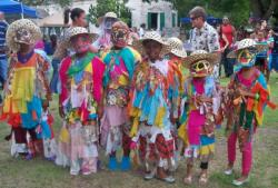 Pearl B. Larsen Masqueraders take part in Family Fun Day, or Fiesta En El Batey.