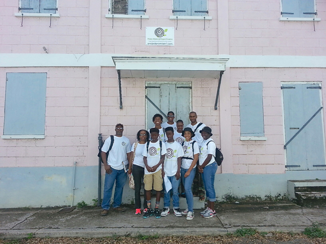 Student volunteers that picked up community assessments standing in front of the Project Promise building. (Photo by Erica Parsons)