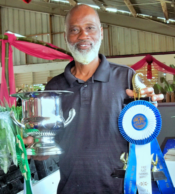 Dale Browne, owner of Sejah Farms holding his trophies from this year's Agrifest.