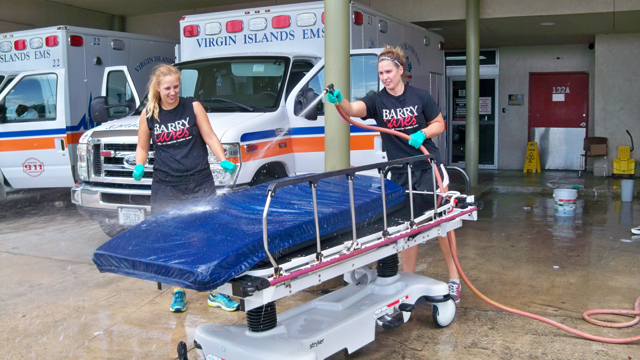Chelsea Nagle, left, and Drea Blaine wash beds at the Gov. Juan F. Luis Hospital as part of a volunteer cleanup.