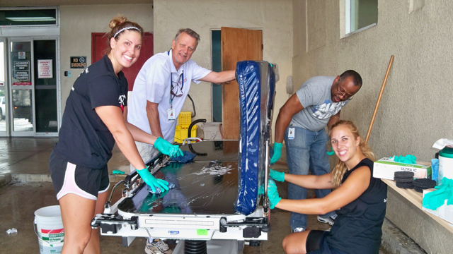 Drea Blaine, left, Mike Funk, Anthony Kiture, and Chelsea Nagle wash beds.