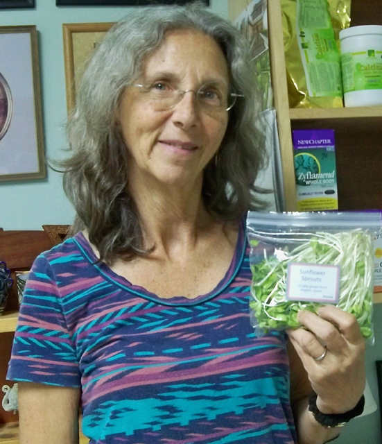 Rhonda Pessin holds a bag of her sunflower sprouts.