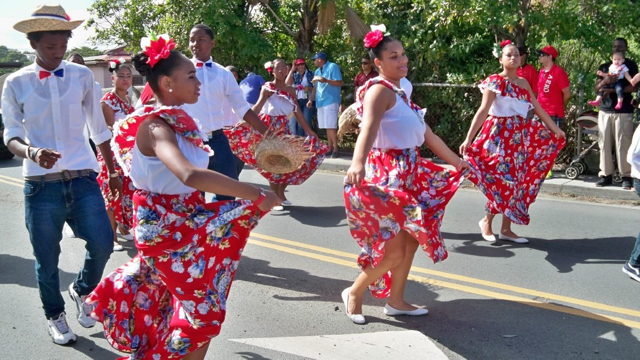 Ballet Folklorico Dominicano dancers delight the crowd lining the parade route Sunday down Christiansted's King Street.