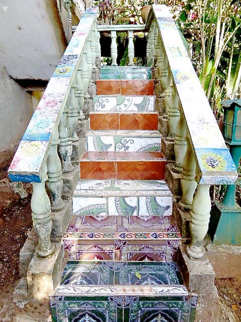 Whimsically painted stairs lead to the home of artist Mario Pelegrin.