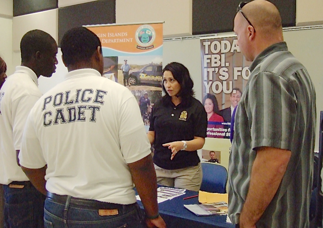 An FBI representative talks to police cadets about careers with the bureau during Monday's Career Fair at UVI. (Susan Ellis photo)