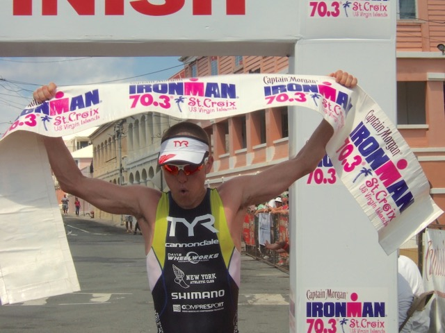 Matt Chrabot crossed the finish line in first place in his first St. Croix 70.3 Ironman.