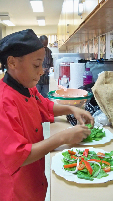 T'Anna Lake, a sixth grader at Free Will Baptist, prepares salad.