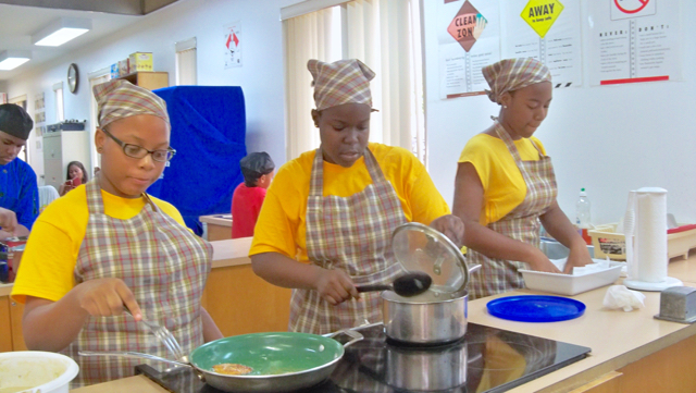 Thai-Lee Missick, left, Nyana Francois and Laurie Cedeno, Elena Christian students, compete in the 'Super Chef' competition.