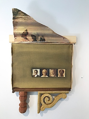 A mixed media piece, 'The House that Sugar Built,' incorporates photos and found objects. (Photo provided by Janet Cook-Rutnik)