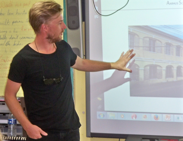Simon Sjogaard talks about the restoration of the old Danish Army Barracks Monday at Good Hope Country Day School.