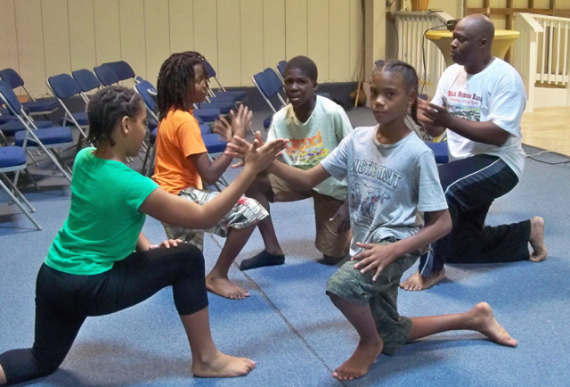 From left, J'Neelah Daniel, Jahmani Graham, Ricardo Caleb and Ezekiel Williams learn Capoeira under the direction of Rudy O'Reilly.