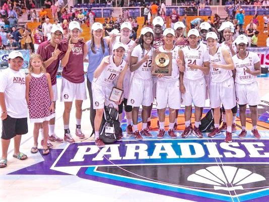 The Florida State University women's basketball team celebrates winning the Reef Division of the Paradise Jam women's tournament Saturday at the UVI Sports and Fitness Center. (Photo provided by Paradise Jam)