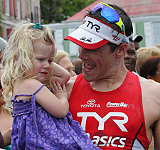 Men's winner Andy Potts with his smallest fan, daughter Sloane.