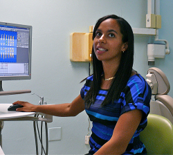 Dr. Talia Moses demonstrates the digital imaging and record-keeping technology at the new dental clinic.