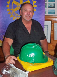 David Tourigny, St. Croix CERT coordinator, shows what a CERT backpack should contain.