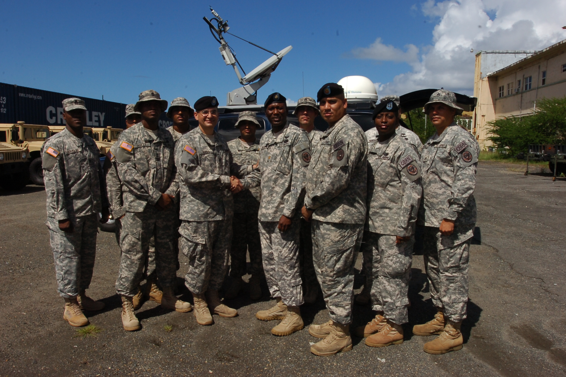 National Guard Lt. Col. Carlos Rivera (center) thanks V.I. National ...