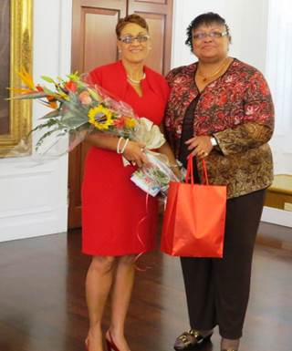 Monique Mari Motta, left, V.I. State Teacher of the Year, accepts flowers and gifts from Commissioner of Education Sharon Ann McCollum Ph.D. at recognition ceremony Jan. 14.
