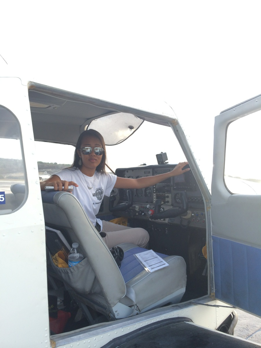Regine Rose Acosta in a Beechcraft Musketeer aircraft