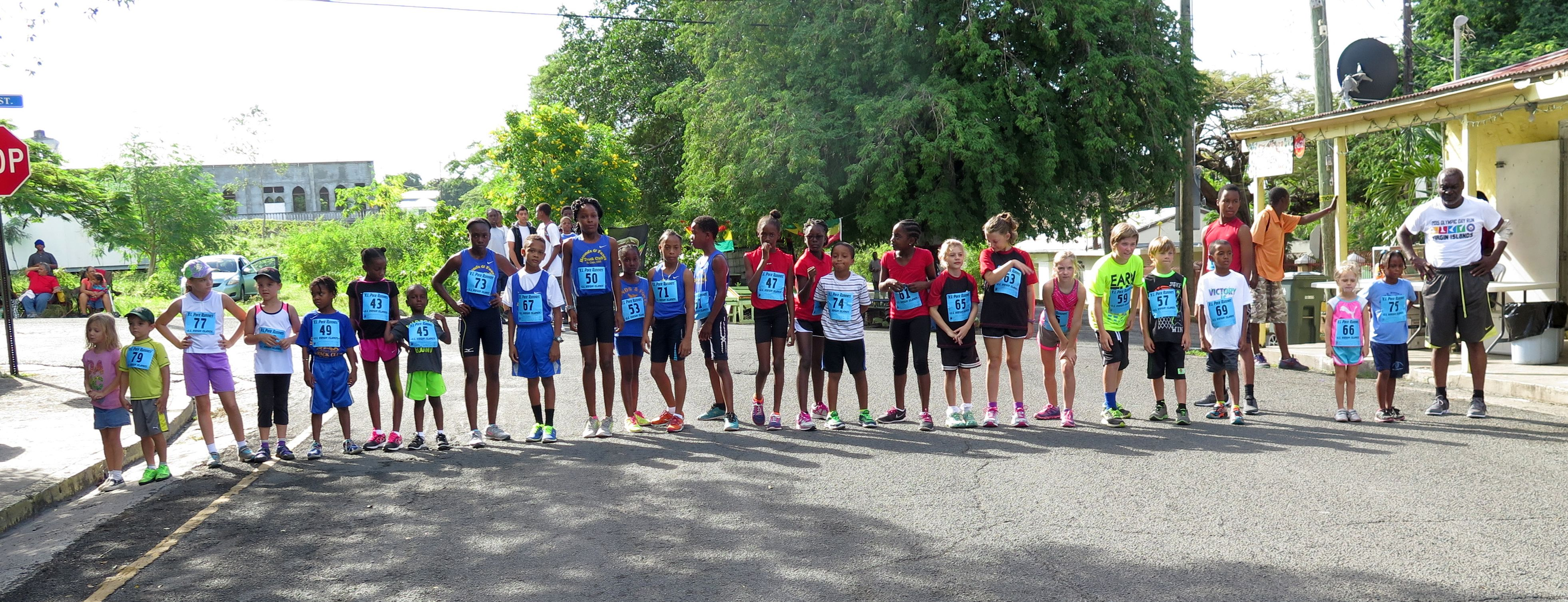 Children Race runners line up at starting line.
