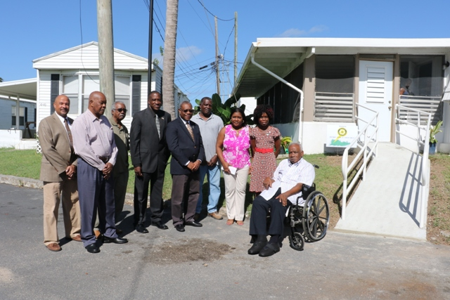 Members of St. Croix Rotary Club West deliver wheelchair ramp to Veteran Calvin Burke.