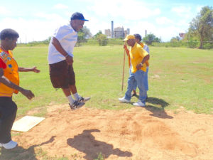 Leon Vanbeverhoudt gets some air in the long jump at the St. Croix Special Olympics.