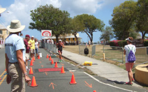In the 2015 Ironman Lauren Goss begins the 13.1 mile foot race, and was the first across the finish line. (Susan Ellis photo)