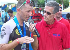 Francky Favre talks to Dave Ragsdale Sunday after winning the 29th – and final – St. Croix Ironman in a tie of 4:42:07.