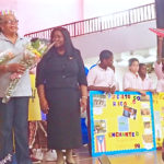 EarlyAct instructors Liz Goggins and Sandra Gerard-Leung are presented crowns and flowers by Gardine Vice Principal Anna Gordon and members of the club.