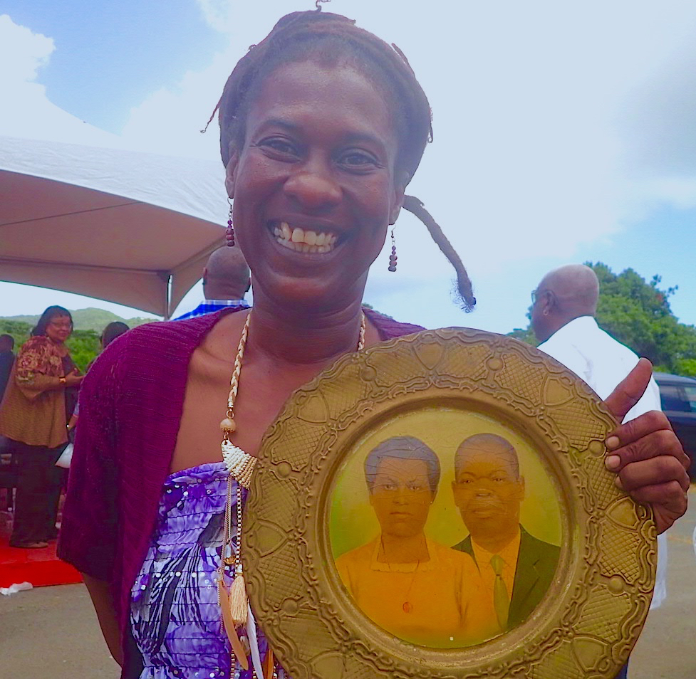 Meloma Lewis proudly displays a plaque of her grandparents, Paul E. and Elaine Joseph, during the groundbreaking for the Paul E. Joseph Stadium.