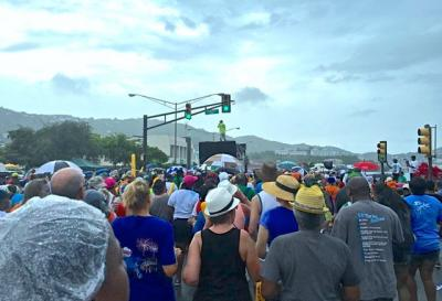 Crowds pack in between the J'ouvert band