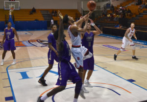Brock forward Dani Elgadi drives to the hoop through a host of James Madison Dukes.