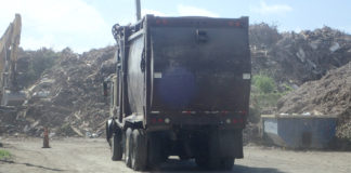 A trash truck hauls waste to the landfill on St. Croix. (File photo)