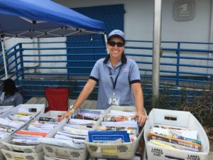 Postal worker Debbie Querrard hands out mail to St. John box holders, as a sense of normalcy slowly returns to the territory. (Amy Roberts photo)