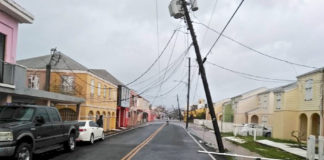 A power pole tilts precariously over Queen Street in Frederiksted. (Photo from Angel Santiago's Facebook page)
