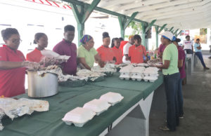 Student Ambassadors from UVI's 4-H Youth Development pack and serve food.