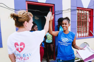 Cane Bay Cares volunteers distribute water to the Boys and Girls Club in Christiansted. (Photo by Nicole Canegata)