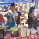 Vendors serve up food. (Jamie Leonard photo)