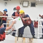 Crew from Coast Guard Cutter Winslow Greisser transfer critical prescription medication for delivery to St. Croix Saturday. (Coast Guard photo)