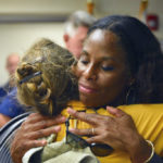 Delegate to Congress Stacey Plaskett embraces a Virgin Islander after the territory was hit by two category five hurricenes. (Photo from Plaskett's offical website)
