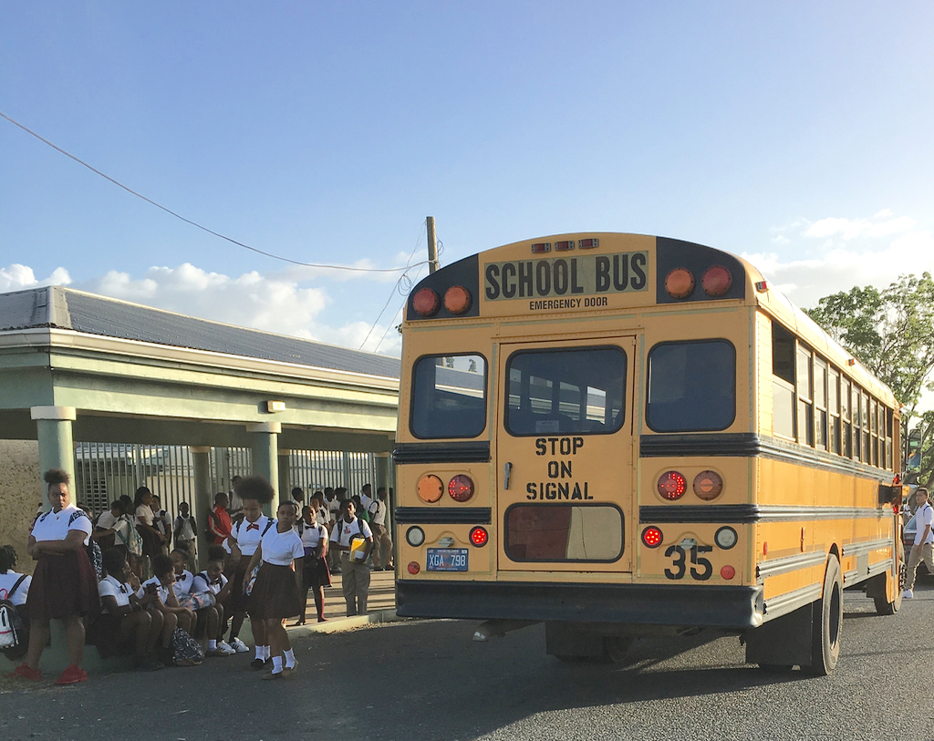 Students unload from the school bus Monday at St. Croix Central High School.