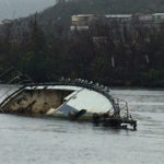 A sunken boat lies int eh water off St. Thomas. It is on of at least 336 sunken vessels recorded int he territory.