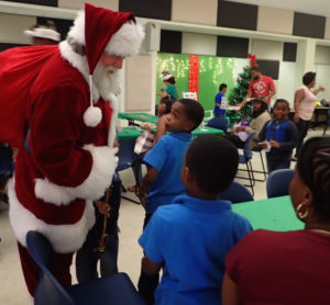 Santa talks to children about their Christmas decorations.