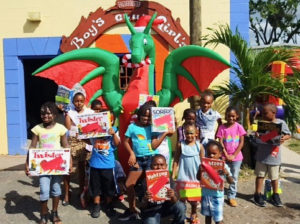 Youngsters at the Frederiksted Boys and Girls Club display their new board games. (Photo by Jessica Parker)