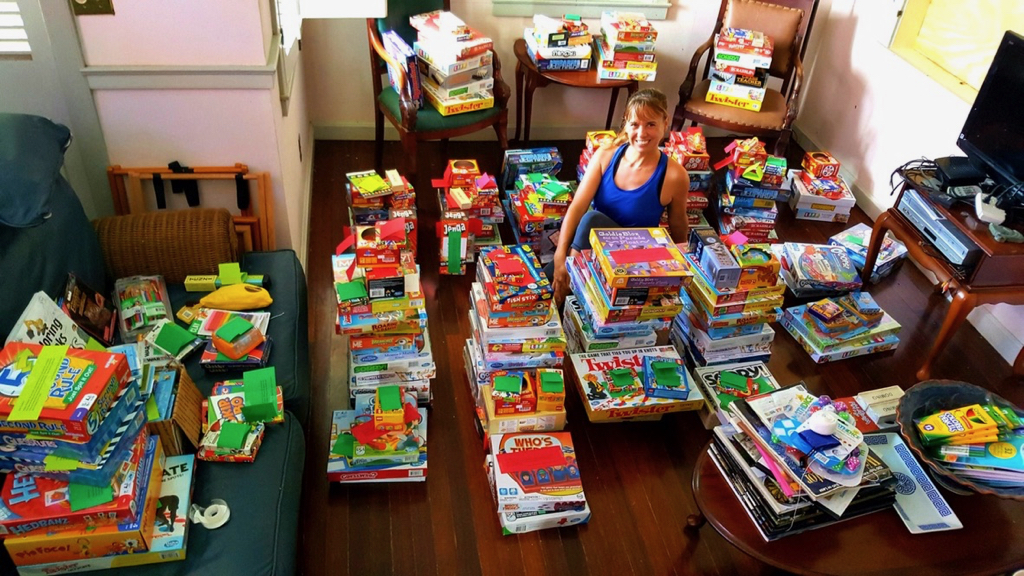 Jessica Parker, somewhere int he middle, stacks her livingroom with games.